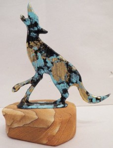 Coyote pewter with a sand stone base
