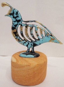 Quail pewter with a sand stone base
