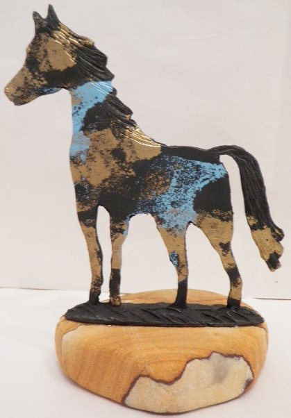Horse pewter with a sand stone base